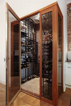 A wine cellar in the kitchen.  Somehow, I don't think it would be very full very often...