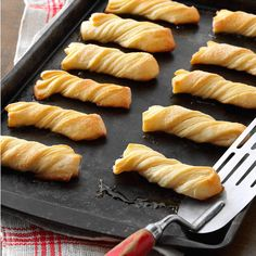 """Evelyn's Sour Cream Twists Recipe -""""Evelyn"""" is my mother-in-law, who always keeps some of these terrific flaky twists in her freezer to serve in a pinch. They go quickly around our house— especially during the holidays. Babka Recipe, Knead Bread Recipe, No Knead Bread, Cinnamon Twists, Cinnamon Bread, Twisted Recipes, Christmas Appetizers, Fancy Appetizers, Christmas Foods"""