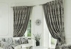 Curtains. Get heavy ones to block out sound