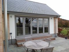 These sliding folding/ bi fold #doors are an ideal solution in this location. When the weather allows all five doors slide back to allow an unobstructed view of the coast. The doors are made from from #hardwood and we painted them in http://www.littlegreene.com/lead-colour
