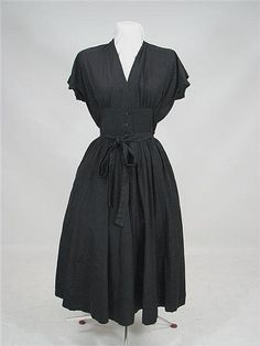 An early 1950s Horrockses day dress in polished black cotton