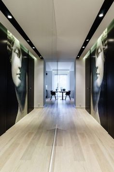 This Apartment Will Inspire You To Go Bold With Your Decor #refinery29  http://www.refinery29.com/design-milk/32#slide-7  The mirrored hallway adds dimension and makes the space feel larger.