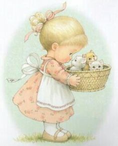 Our littlest grand-darling at the Cottage is most happy with a basket of kitties...