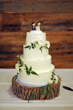 Rustic buttercream cake with foliage (and a pre-bought cake topper). The Occasional Cake Company can make you a bespoke cake topper which would be a lot nicer!