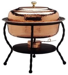 """Old Dutch 161/2""""x121/2""""x18"""" Oval Décor Copper Chafing Dish, 6 Qt by Old Dutch. $185.38. 6 quart capacity. Gel fuel not included. Lacquered to resist tarnishing. Hand-crafted by skilled artisans. 16.5"""" x 12.5"""" x 18"""". For serving pieces worthy of a royal buffet, look no further than Old Dutch¿s ¿De La Cuisine¿ collection of elegant chafing dishes. Offered in both polished and antiqued copper finishes, these impressive chaffers feature stainless steel food liners in 3, 6 and ..."""