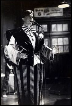 """David Bowie performing on Saturday Night Live,1979, in a costume inspired by a design by Sonia Delauney for Tristan Tzara's play """"Le Coeur a Gaz"""", 1923.....designed by Mark Ravitz and David Bowie"""