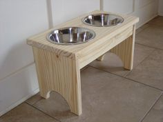 Tim and I made a raised dog bowl like this one!  This one is nicer because we just used scrap wood we had.