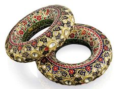 A pair of anklets, Kadas from Jaipur circa 19th century.  Each anklet is set with a series of twelve rose-cut diamond flower heads on the convex edge to a gold and dark blue enamel background, the sides with floral and foliate polychrome enamel on a white ground to a central line of green and gold decoration, opens by way of screw fitting.