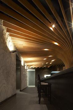 The smooth organic wooden texture juxtapose with the rough stucco surface.