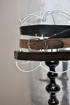 old leather belts on this vintage lamp frame - not my style but pretty dang cool & I love the masculine vibe