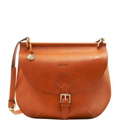I adore the clean simplicity of this bag. I'm also so excited that its strap crosses the body; it's the swank version of the messenger bag I can't live without. $395