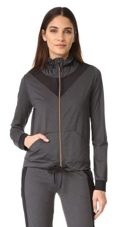 blade pace jacket by KORAL ACTIVEWEAR. A heathered KORAL ACTIVEWEAR jacket styled with sheer mesh inserts. A drawstring cinches the hem and elastic trims th...