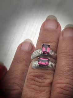 THE most gorgeous emerald cut rhodolite (pinkish) garnets prong set on thick half dome sterling silver. The ring measures about but will fit a little tighter because of its width . Signed on inside with makers mark