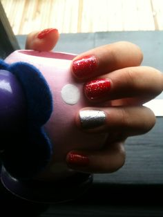 Simple red nails with silver accent finger  Very easy to do. Only three steps