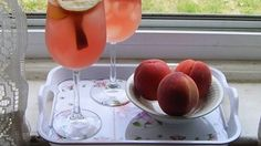 A refreshing twist on the classic wine punch. White wine and peach vodka are floating with white peaches and grapes. A hit at summer parties!