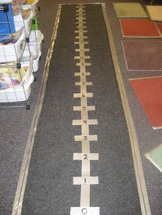 "Large scale numberline made with an inexpensive carpet runner & duct tape ("",)"
