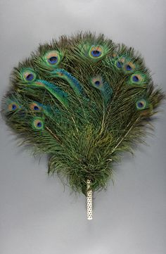Fan: ca. early 20th century, Chinese (possibly), peacock feathers, quills, cotton thread.