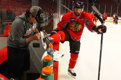 Brad Richards gets his skate looked at.