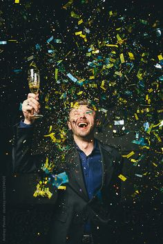 Confetti in front of men dressed in a suit by Andrey Pavlov - Celebrate, Party - Stocksy United