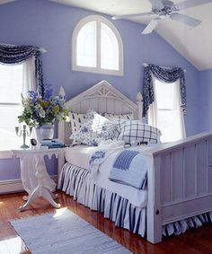 Who wouldn't want to take an afternoon snooze in this room? The guest bedroom is a serenade in blue — from floral window swags to the mismatched pillowcases. The mixing of blue and white is a classic choice; there is no better color combination to ensure a restful, tranquil setting.