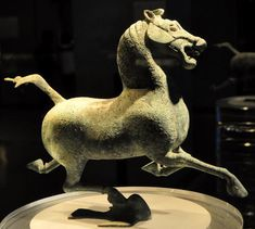 The Ancient Chinese Bronze Galloping Horse Treading on a Flying Swallow (马踏飞燕). Unearthed in 1969 in the Leitai Tomb of the Eastern Han Dynasty (25-220) in Wuwei County, Gansu Province. The bronze statue is a famous representative sculpture of the Han Dynasty.