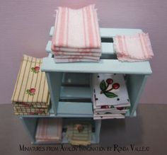 Two dollhouse miniature vintage style shabby chic kitchen towels in white fabric with cherries print from Miniatures from Avalon Imagination on Etsy