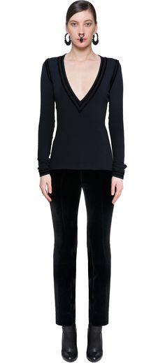 Women's black pants in wool with velvet details, legs stretch and straight, feminine seduction with great elegance and style. Givenchy and its Creative Director defying all dictates and create pieces of great beauty and refinement. Modern cuts and high quality fabrics, so definitely make the difference on clothes like this black pants, embroidered on the legs. If you combined its with a corset from the same brand, you'll do a great big jump in the romanticism era.