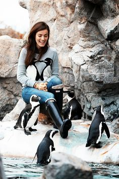 From a distance I thought she was holding two penguins, and I got really excited because I've always wanted to hold penguins...