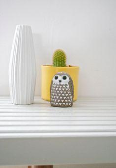 mid-century porcelain vase + swedish owl on slat bench