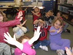 x:  children make x with arms when they hear a word that ends with the x sound