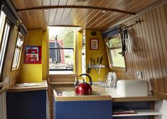 Here is the interior of Queenie, our 2 berth narrowboat for hire in Manchester, England UK.