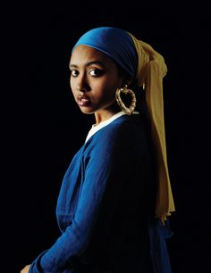 African American Artist special twist on 'girl with the pearl earring' Awol Erizku