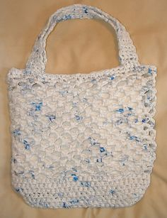 Recycled plastic grocery store bags crocheted into a plastic grocery store bag.  Ingenious!
