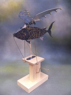 Hey, I found this really awesome Etsy listing at https://www.etsy.com/listing/197162368/blue-flying-fish-automaton