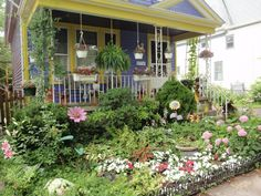 Tropical cottage garden styleSharing Nature's Garden: Cottage gardens enchant and enthrall...