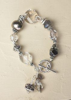 This seasons favorite bracelet sparkles and shines in subtle shades of gray: Rock quartz Swarovski crystal South Sea Pearl Hematite $105.07 CAD