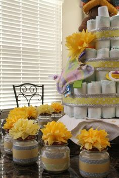 Gray and yellow themed baby shower decor and setup. Pop Baby Showers, Baby Shower Parties, Baby Shower Themes, Baby Shower Decorations, Shower Ideas, Diy Candles In Baby Food Jars, Baby Food Jar Crafts, Baby Jars, Baby Dedication