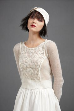 Feminine sweater with a big tulle skirt would also be lovely