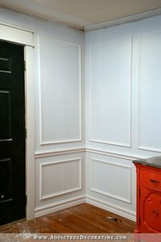 Full wall picture frame moulding in progress - How to install picture frame moulding wainscoting - addicted2decorating.com