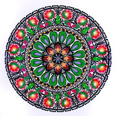 A large circular cutout Lowicz with floral pattern - a traditional folk handicraft - Folkstar.pl