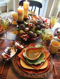 Beautiful table setting - love the dough bowl filled with real pears and grapevine balls.  I can do this!