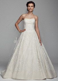 """Say """"I do"""" in this glamorous organza and tulle ball gown! Strapless organza bodice with ultra-feminine sweetheart neckline features intricate glass beading over baroque inspired lace. Long tulle skirt gives this gown a dramatic finish. Chapel train. Fully lined. Dry clean only. To preserve your wedding dreams, try our Wedding Gown Preservation Kit.This neckline is shaped like the top of a heart and is flattering to the decolletage.Train that extends one and a third yards (about 4 feet) from…"""