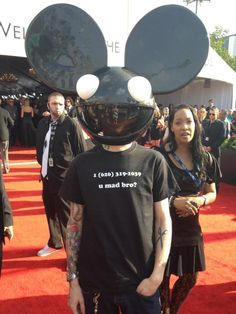 #Deadmau5 at the Grammys with #skirllex phone number on his shirt. gotta love that guy