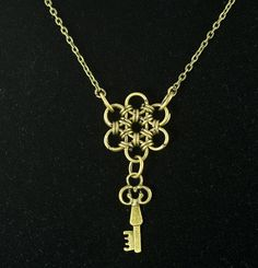 Chainmail skeleton key necklace from Etsy.  The subpendant doesn't have to be a key though...