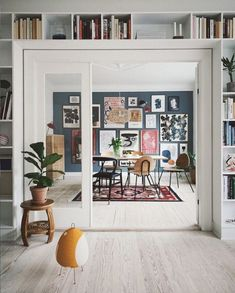 Double doors, book shelves an gallery wall in An Artful And Relaxed Apartment In. Double doors, book shelves an gallery wall in An Artful And Relaxed Apartment In Aarhus, Denmark (+ Get The Look) Dark Blue Walls, Decoration Bedroom, Wall Decor, Home Decoration, Scandinavian Home, Interior Exterior, Double Doors, Interiores Design, Home Design