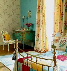 Beautiful bedroom, love the wallpaper, color and that patchwork bedspread.