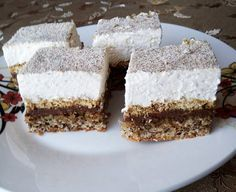 Reteta prajitura parlament cu nuca si biscuiti - una dintre cele mai bune prajituri de casa. Poti folosi nutela sau fineti pentru a...