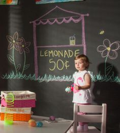 This amazing craft room, designed by @Lauren Nicole Designs, is not only functional, but FUN! #playroom #chalkboardwall