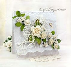 Hello everyone Today I'd like to share with you a wedding card. It has many layers made of paper, tulle and lace. I decorated the card using white WOC roses and leaves.   Have a nice Thursday! Klaudia