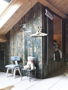 I don't have a little boy anymore...but this is genius. a hideout bed area created from weathered wood. That denim covered chair is pretty inventive, too. Shannon Berrey Design Blog
